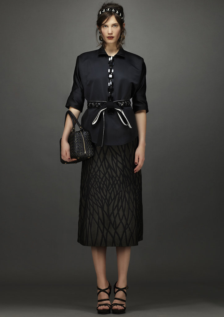 Pair this pencil skirt with a blouse when you want to take your outfit from night to day. Source: Marni