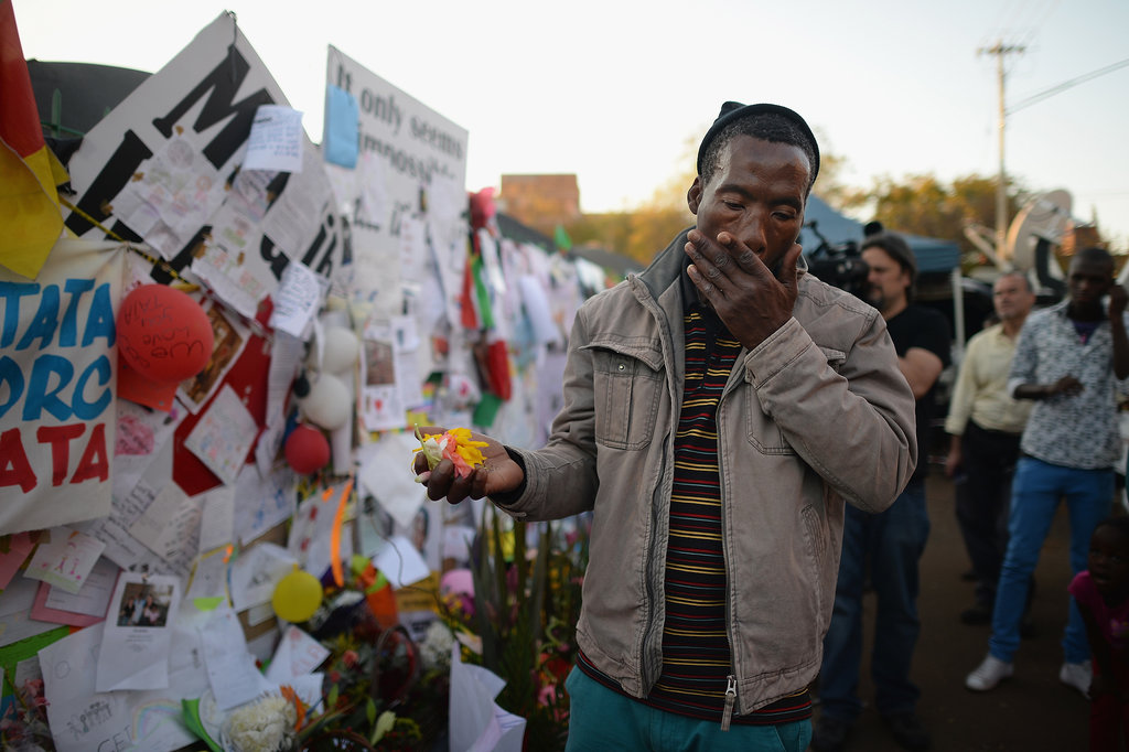 A man became emotional after praying for Mandela outside the hospital in Pretoria, South Africa.