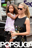 Heidi Klum carried her daughter Lou Samuel while shopping in NYC on Monday.