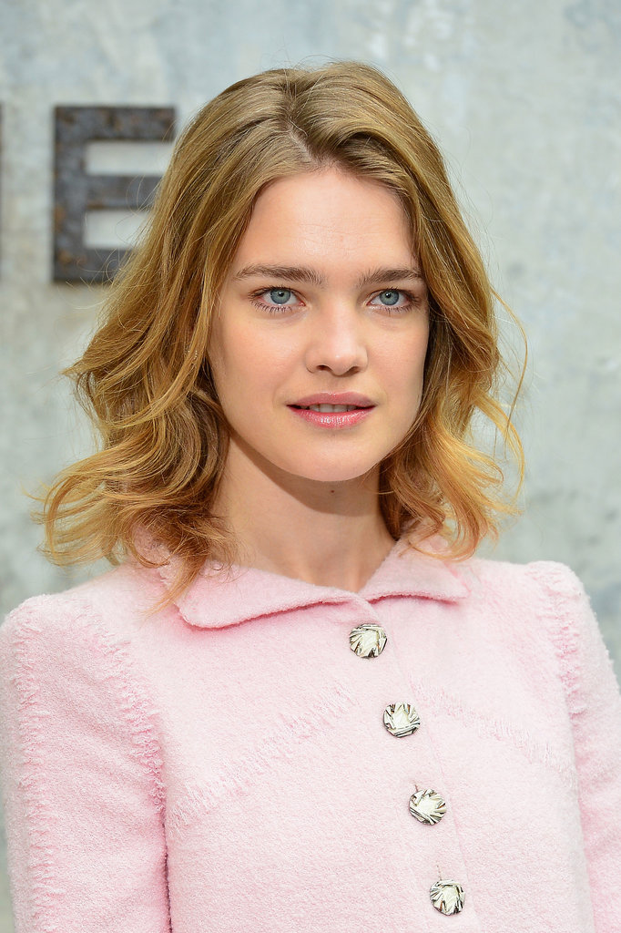 Model Natalia Vodianova sat front row at Chanel with barely-there makeup, save for a touch of soft pink lip colour. She complemented the natural look with loose waves.