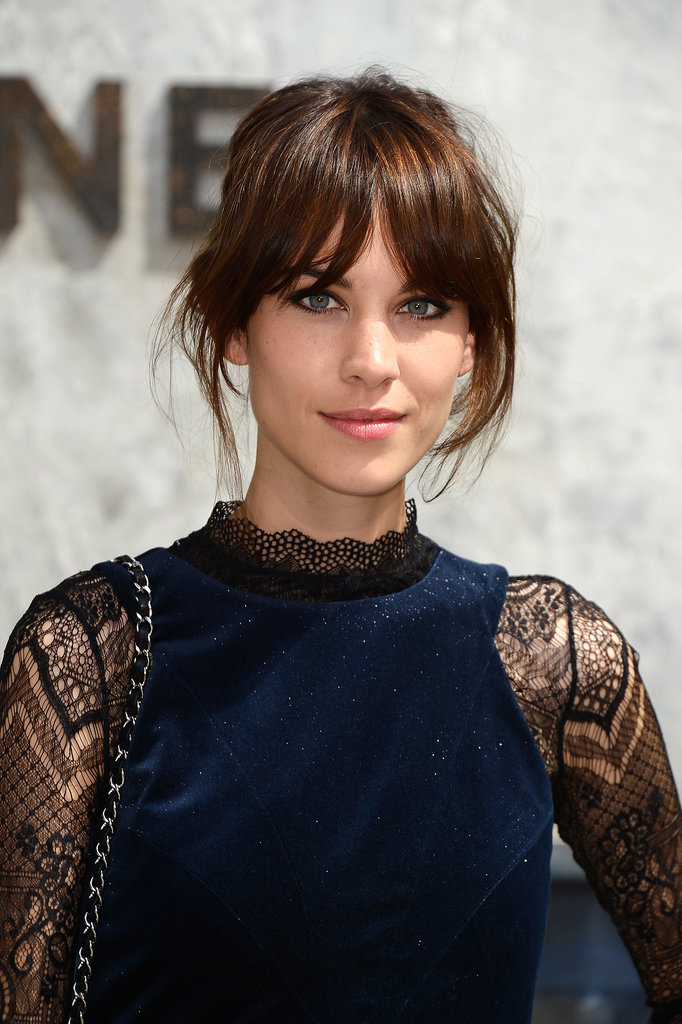 Alexa Chung was also spotted at Chanel. She pulled her hair back, but kept her signature fringe tousled and slightly parted in the center. She lined her eyes and went with a soft pink lip color.