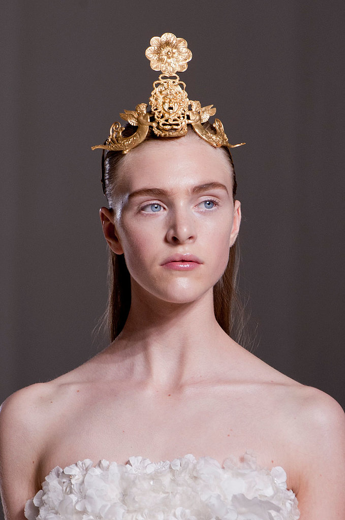 For Giambattista Valli, the bold brows were the main event of the barely-there makeup palette. In contrast, the dramatic, half-up hairstyles were topped off with gorgeous metal tiaras.