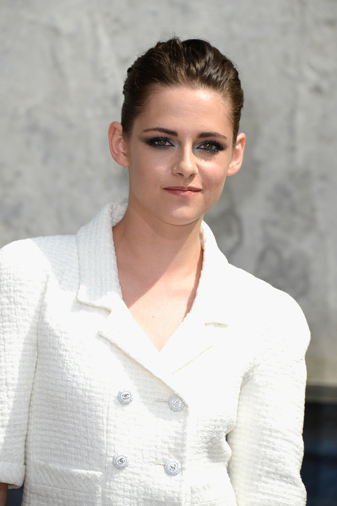 Kristen Stewart brought her edge factor to Chanel with a slicked-back hairstyle and metallic blue winged eye shadow.