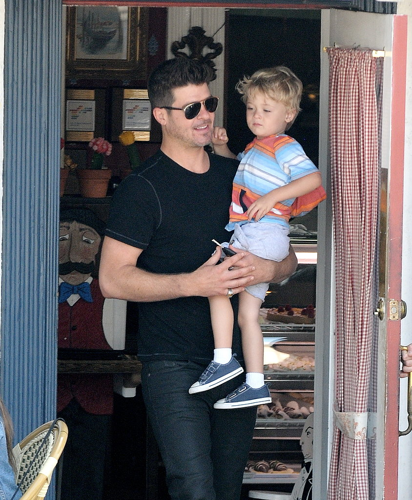 Robin Thicke carried his son, Julian Fuego, in LA.