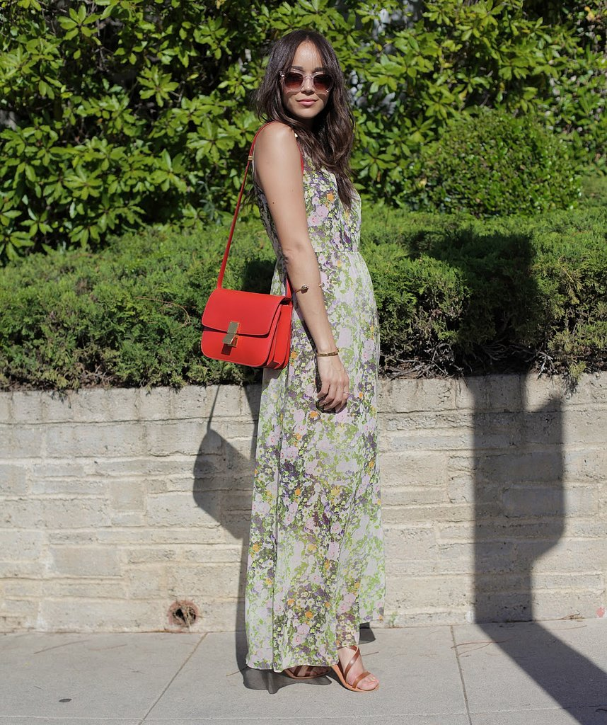 Ashley Madekwe owns the same Madewell floral maxi! Her version included a red structured bag and tan high-heeled sandals.   Source: Ring My Bell