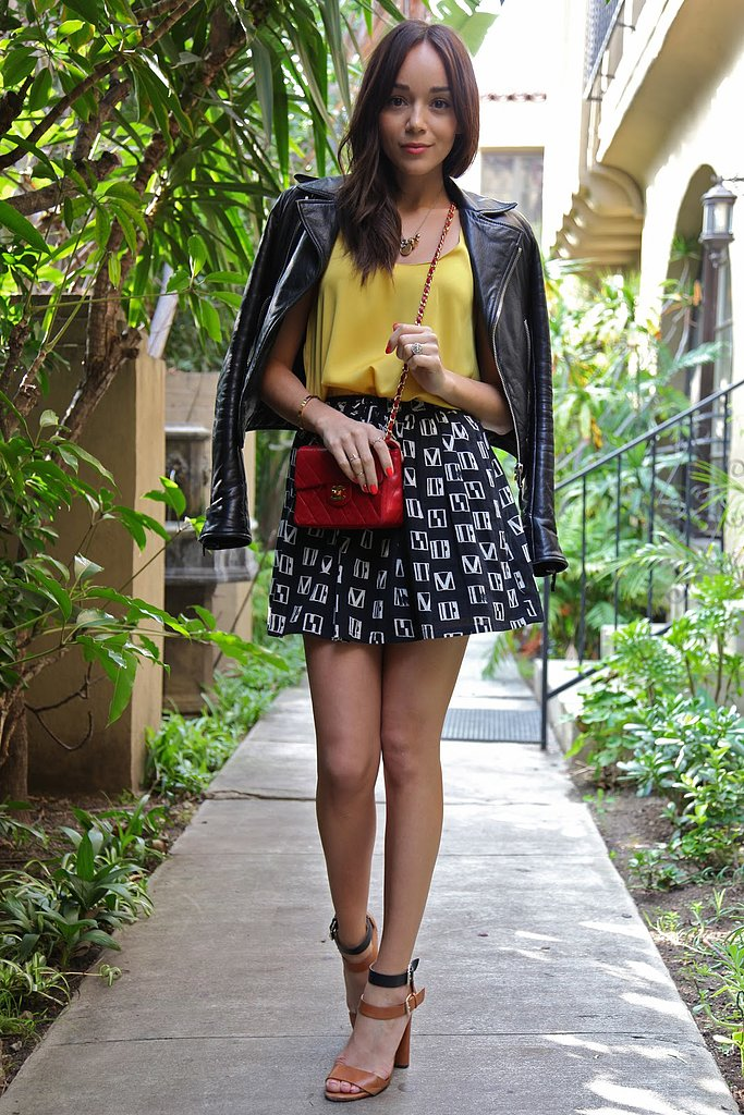 The printed Madewell skirt Ashley Madekwe sported with a yellow tank and red Chanel bag created a statement Summer style.   Source: Ring My Bell