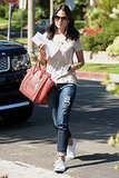 For a sportier outfit, look to Jordana Brewster and match your favorite denim with sneakers. A statement bag like her Céline luggage tote will help dress things up just a tad.