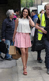Kelly Brook smiled on set for Taking Stock in London on Tuesday.