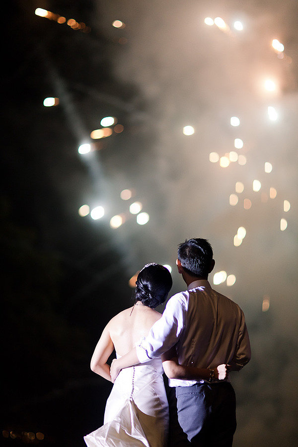 This romantic Balinese wedding featured fireworks at the end of the night. Photo by Erin Hearts Court via Style Me Pretty