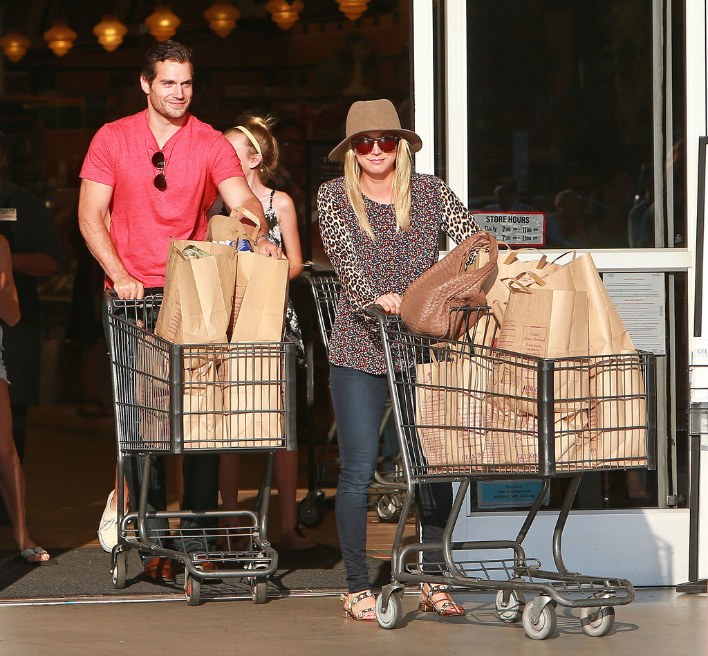Henry Cavill and Kaley Cuoco headed out of the store with their groceries.