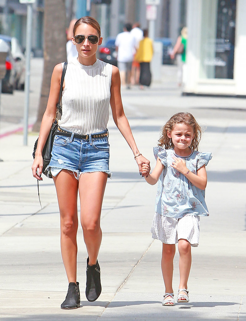 Nicole Richie wore cutoffs and a white tank top.