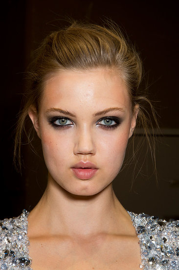At Alexandre Vauthier, model Lindsey Wixson showed off a dark and sultry eye makeup look with silver on the inner corners for a touch of intrigue.