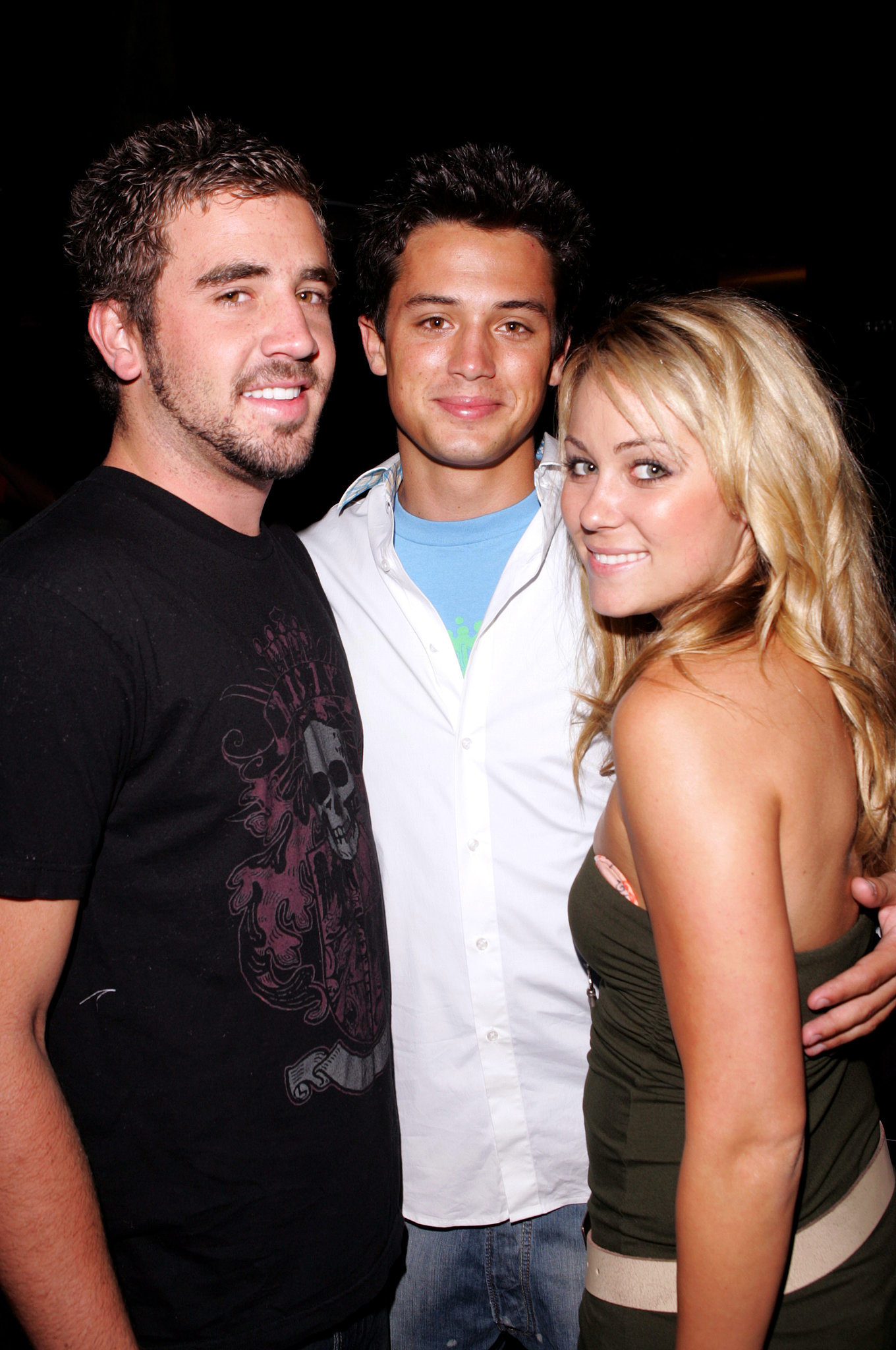 Jason Whaler, Stephen Colletti, and Lauren Conrad cuddled up at a September 2005 party