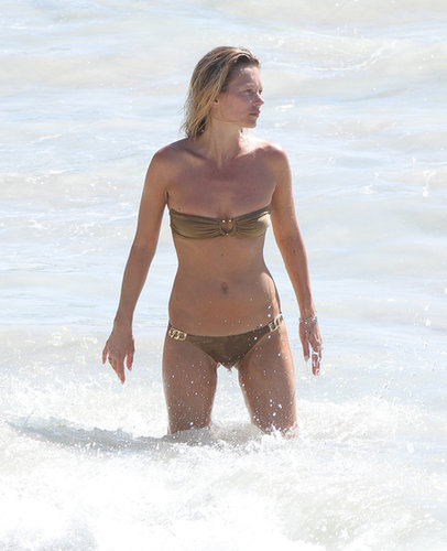 Kate Moss took a dip in St. Barts in December 2012 and showed off her model physique in a shiny bikini.