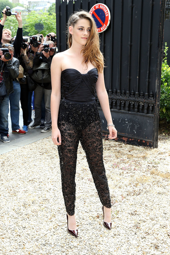 Kristen Stewart wore a lacy jumpsuit for the Zuhair Murad runway show on Thursday.