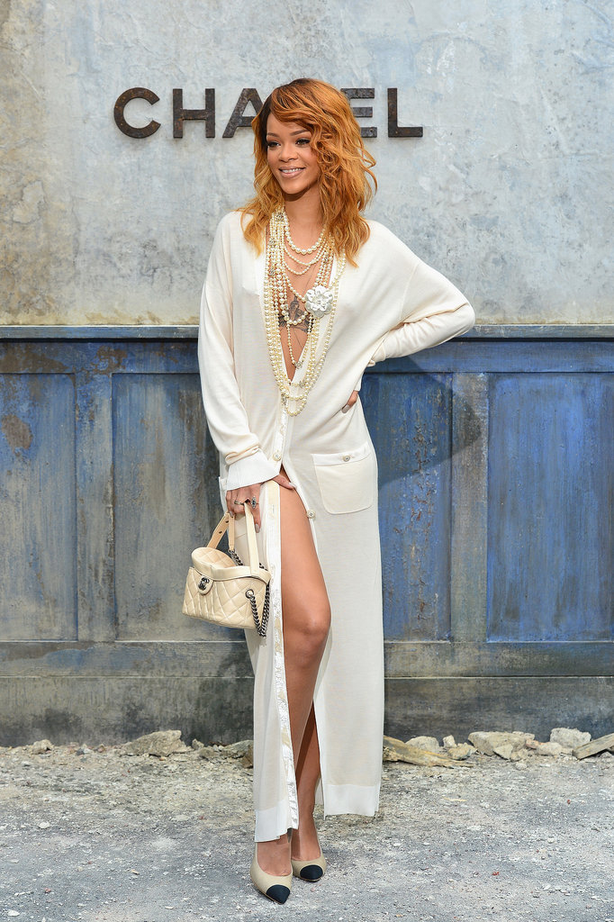 Rihanna struck a pose — strategically — outside the Chanel haute couture fashion show on July 2.