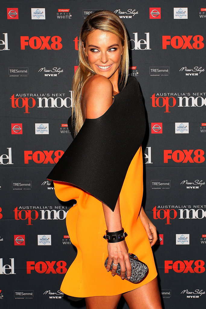 Jennifer Hawkins showed off her fresh post-honeymoon tan at the launch of the latest season of Australia's Next Top Model on July 4.