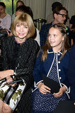 Anna Wintour flashed a pretty smile (!) while she sat with Baz Luhrmann and Catherine Martin's daughter, Lillian, at the Valentino show on July 3.