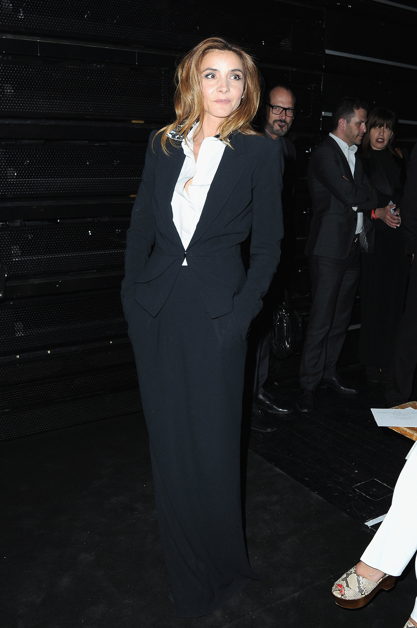Clotilde Courau matched the black color palette at Viktor & Rolf's Haute Couture show.