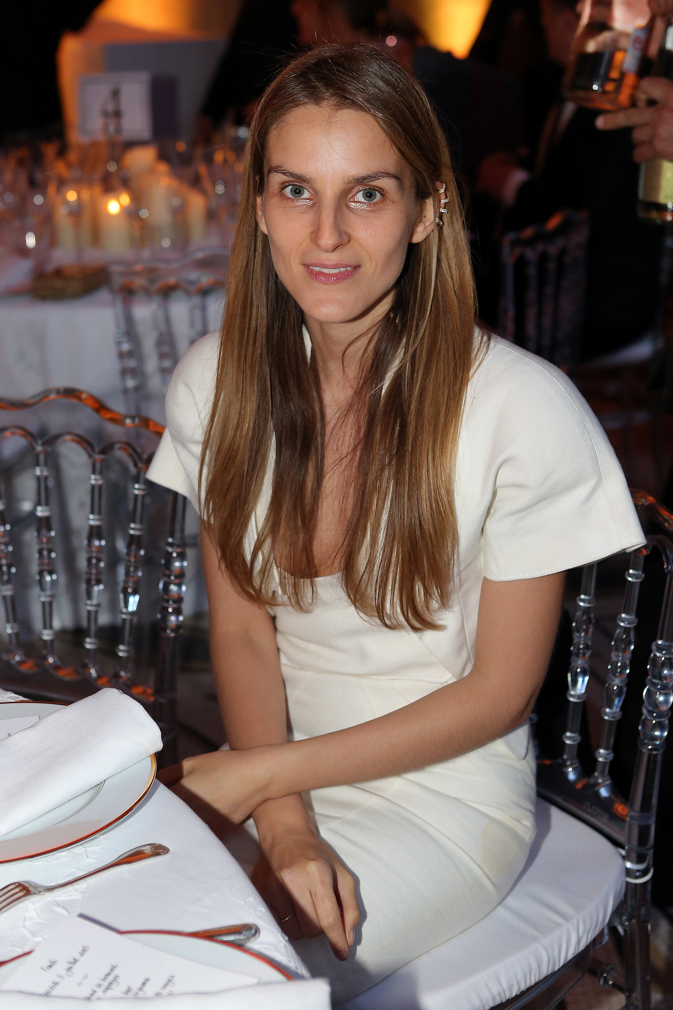 At Fendi's private dinner, Gaia Repossi styled her edgy jewelry designs with a white