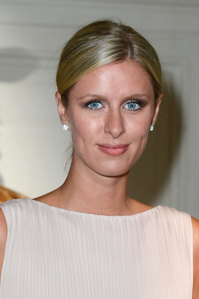 Nicky Hilton opted for minimal makeup and a demure low bun front row at Valentino.