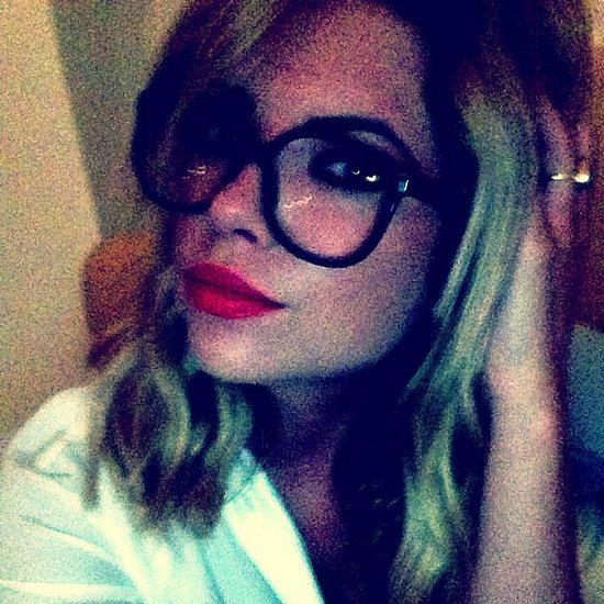 Ashley Benson's red lipstick and eyeglasses made for a fun combination. Source: Instagram user itsashbenzo