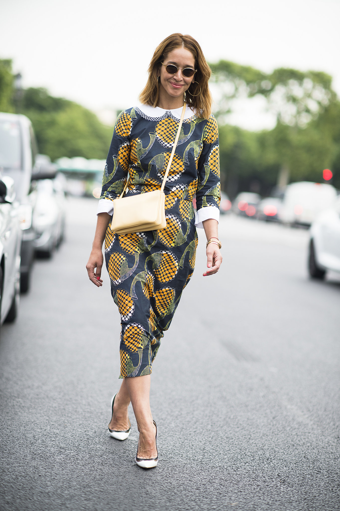 Fresh pineapples felt right at home on the streets of Paris when paired with chic ivory accessories. Source: Le 21ème | Adam Katz Sinding