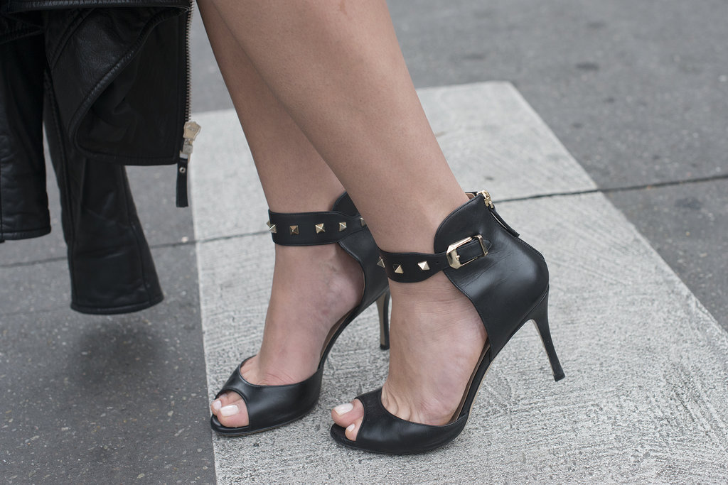 Gold studs amp up black peep toe sandals.