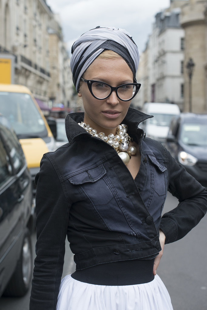 From the head scarf and the pearl bauble earrings to the cat-eye sunglasses, this fashionista is retro-glam.