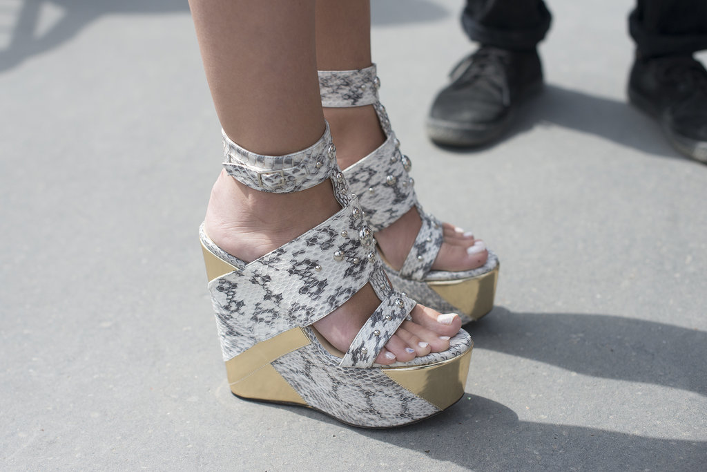 These Jimmy Choos combine everything we love about a Summer sandal — wedges, straps, and a great graphic pattern.
