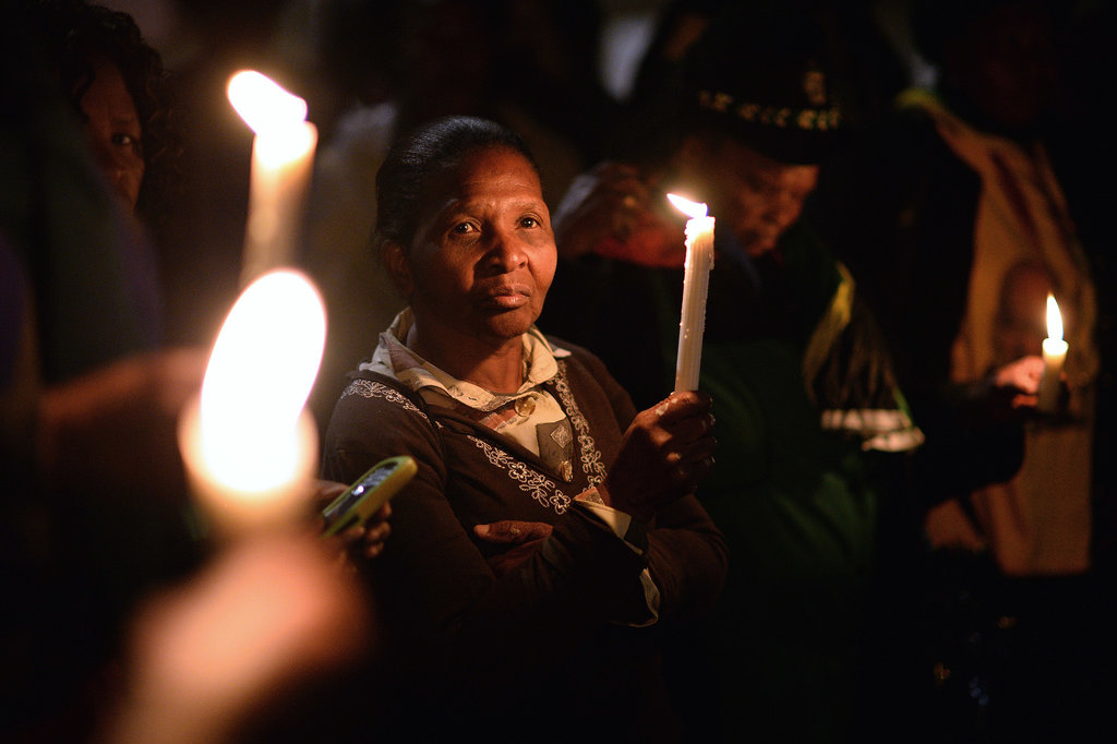 People lit candles as part of a tribute to Mandela.