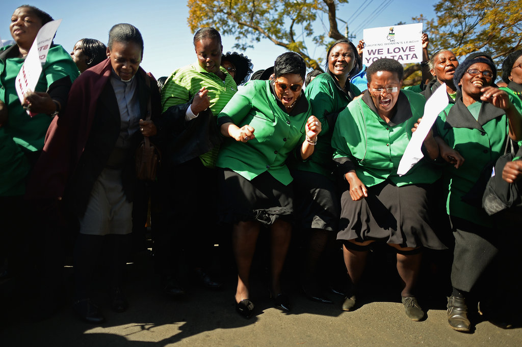 The African National Congress Women's League sang, danced, and prayed in support of Mandela outside the hospital.