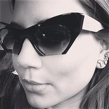 Vogue Australia's fashion director Christine Centenera rocked a serious pair of sunglasses (and some cute Afirca-shaped earrings). Source: Instagram user centenera