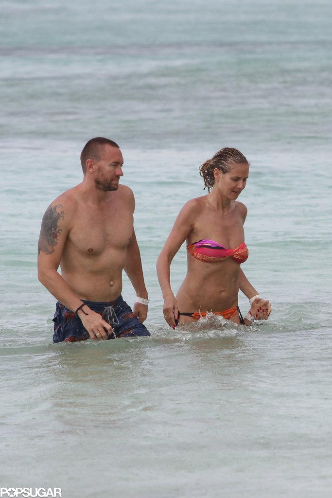 Heidi Klum frolicked in the ocean with her boyfriend, Martin Kristen.