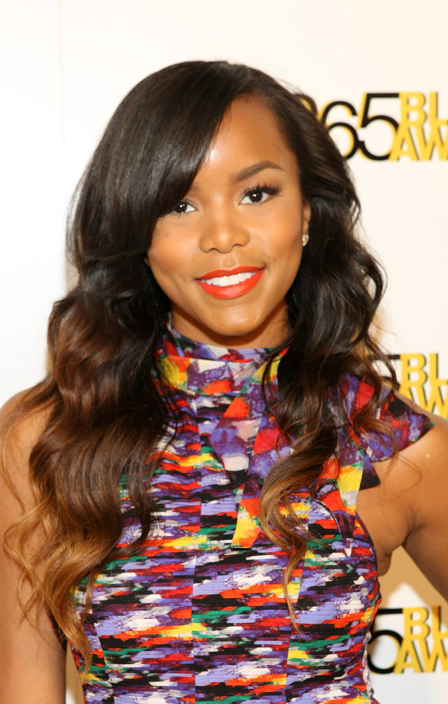 Singer LeToya Luckett looked darling with voluminous waves and a pop of tangerine on her lips.