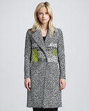 If you've been hankering for a new Fall coat that's fashion forward but professional, we suggest picking up this printed Diane von Furstenberg option ($745) (that has just a touch of neon).