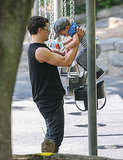Orlando helped Flynn into a swing in Central Park on July 6.