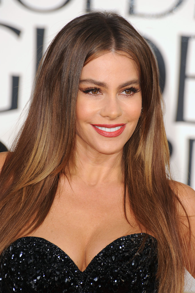 Sofia held bombshell status at the 2012 Golden Globe Awards with red lipstick, an extended cat eye, and a polished blowout.