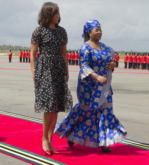 While being escorted to Air Force One by Tanzanian First Lady Salma Kikwete, Michelle Obama showed off a black-and-white printed dress with red kitten heels.