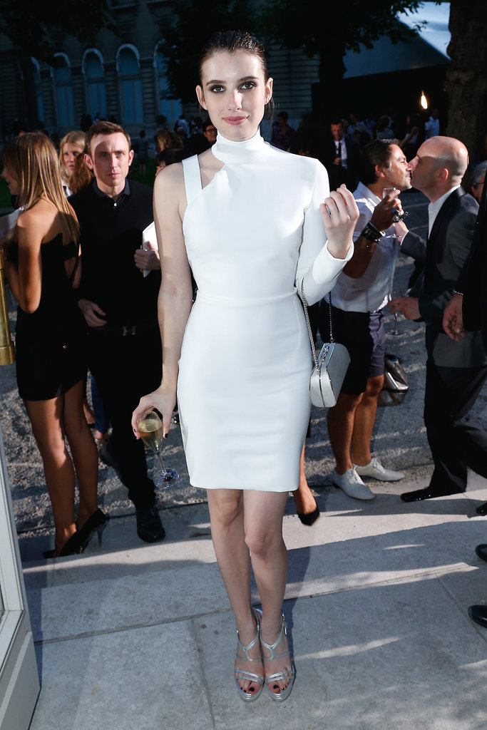 At Paris Haute Couture Fashion Week, Emma Roberts exuded futuristic-chic in her white asymmetrical Versace dress and silver strappy sandals.