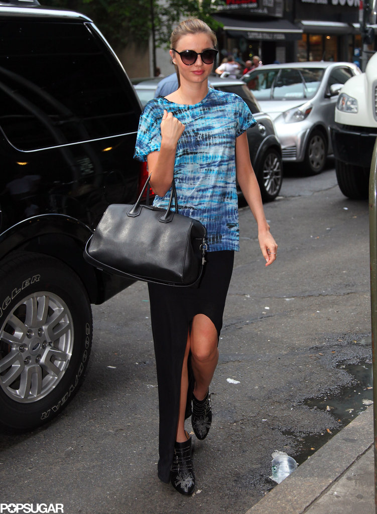 Miranda Kerr's bright tie-dyed tee stood out against a black maxi skirt featuring a sexy front slit. For accessories, the model stuck to studded Chloé boots, oversize sunglasses, and her trusty Givenchy bag.
