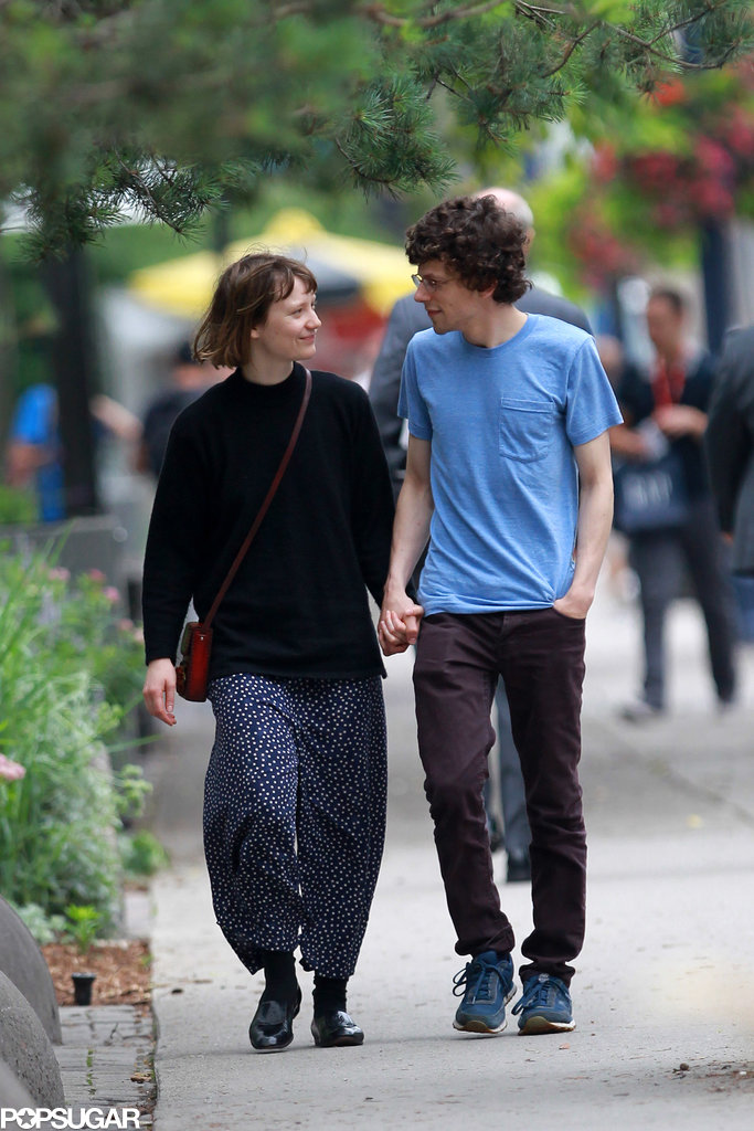 Jesse Eisenberg held Mia Wasikowska's hand for a stroll in Toronto.