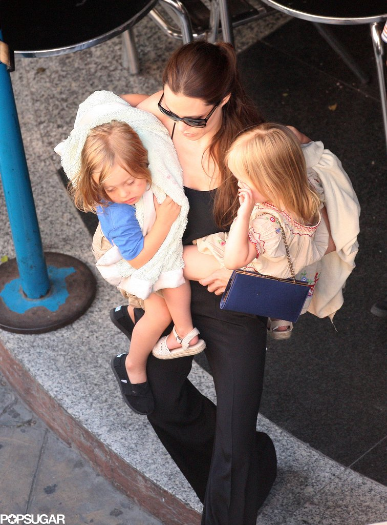 In July 2011, Angelina Jolie had her arms full with both Vivienne Jolie-Pitt and Knox Jolie-Pitt for a day of bowling in Malta.