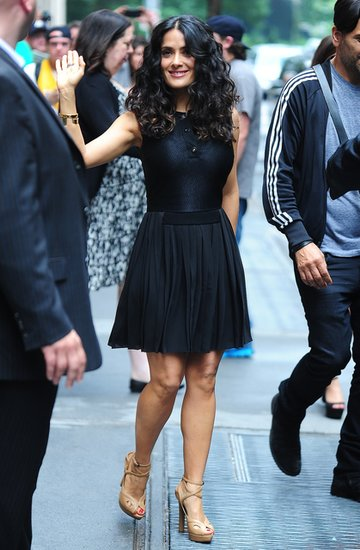 Outside ABC's studios in NYC, Salma waved to fans in a little black pleated dress and sported the same nude sandals.