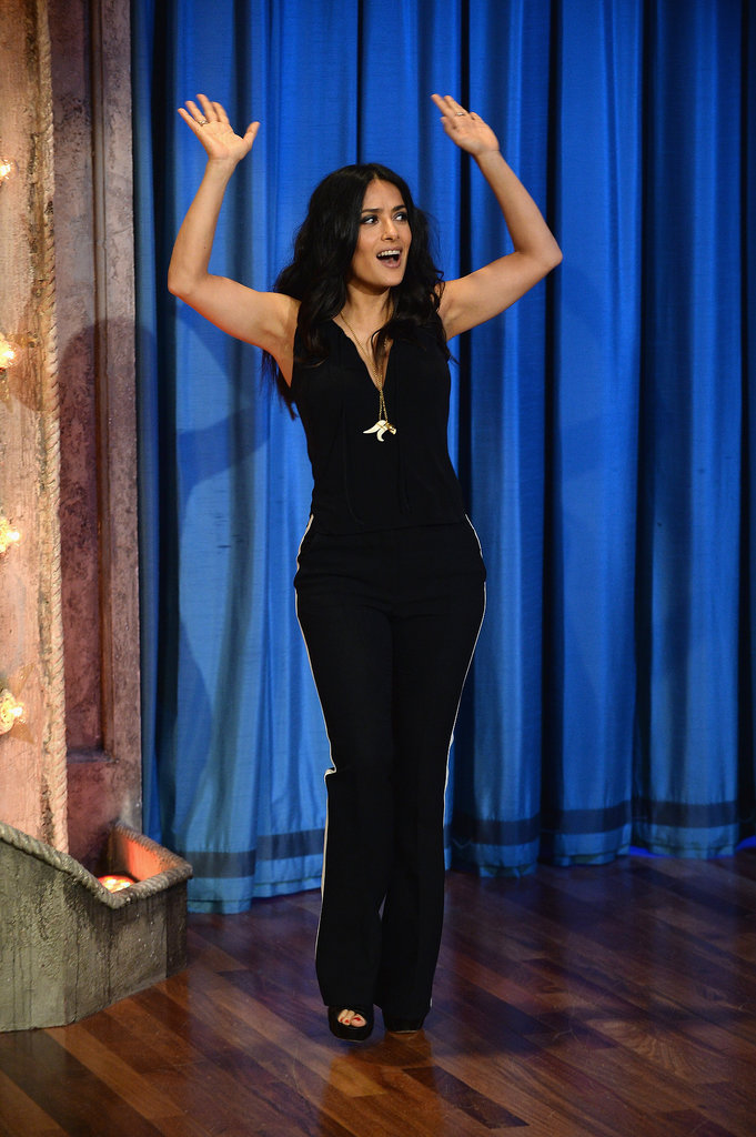 Salma slipped into something more comfortable for her visit to Late Night With Jimmy Fallon. Wearing a black sleeveless top and white-trimmed Stella McCartney trousers, Salma joined the host in a fun game of flip cup.