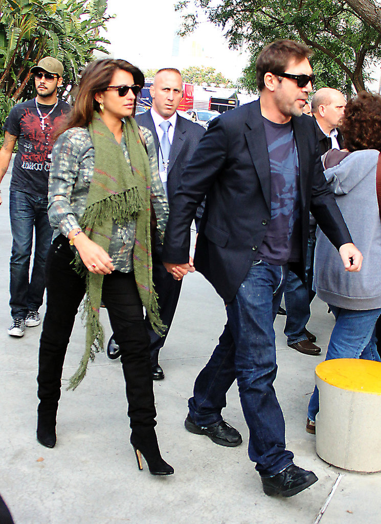 Penélope Cruz held hands with Javier Bardem during a December 2010 stop in LA.