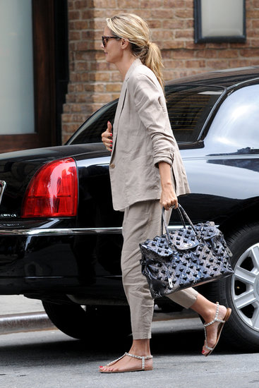 Heidi Klum was relaxed in a beige suit and studded sandals in NYC.