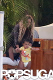 Beyoncé played by the pool with her daughter Blue.
