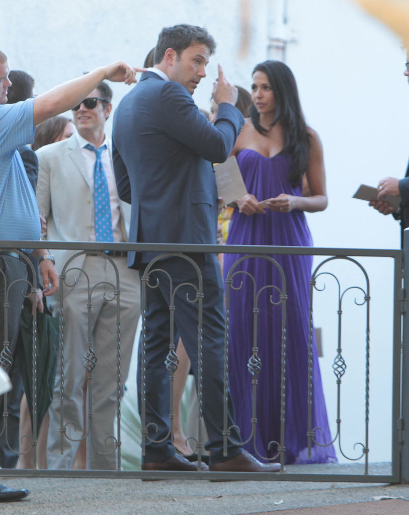 Ben Affleck stood on a balcony with Luciana Damon and Johnny Knoxville.