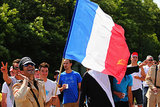 A spectator waved a French flag.